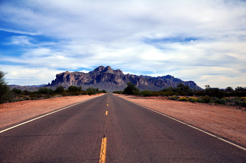 Long paved road leading to the Superstition mountains near Apache Junction, AZ.