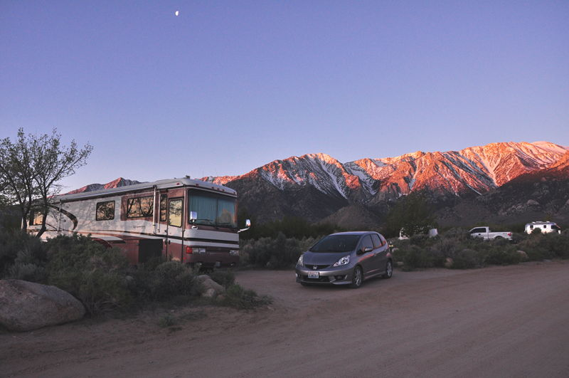 The RV and the Honda sitting in our campsite with the Sierra Nevada mountains in the background.