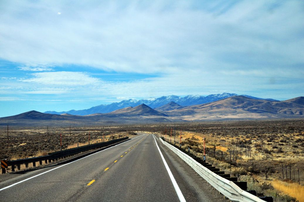 A long road leading to the mountains on our full time RV adventure.