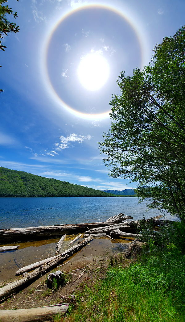 A rare halo is around the sun while hiking along the lake in Mt St. Helens National Park.