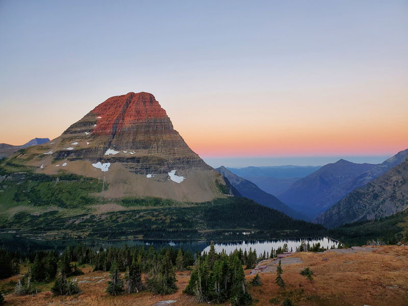 View from the Hidden Lake Overlook trail in Glacier National Park at sunrise.
