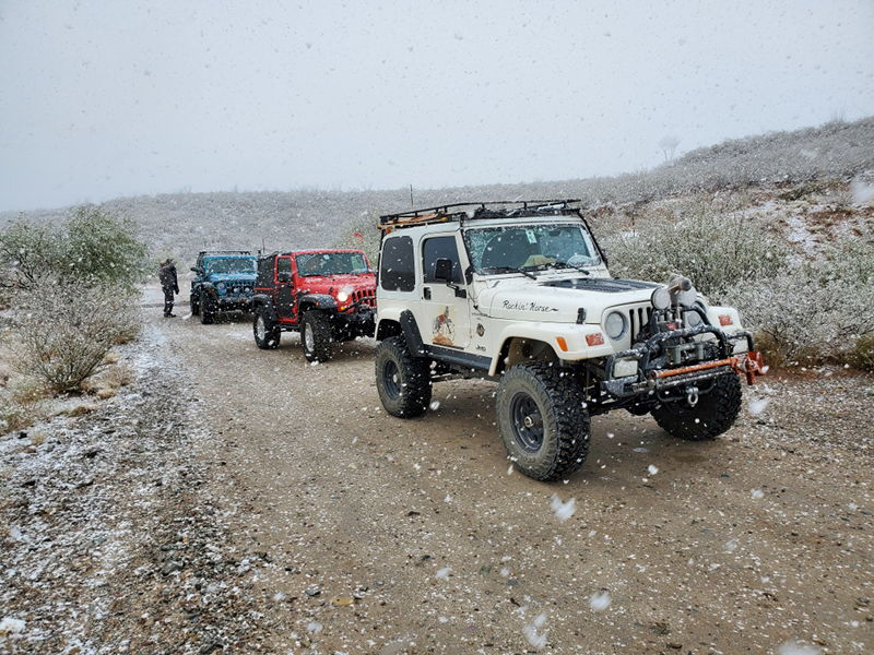 Jeeping out in the desert during a snowstorm.