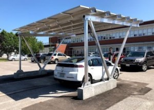 An EV fast charger in Venture 13 parking lot behind the building