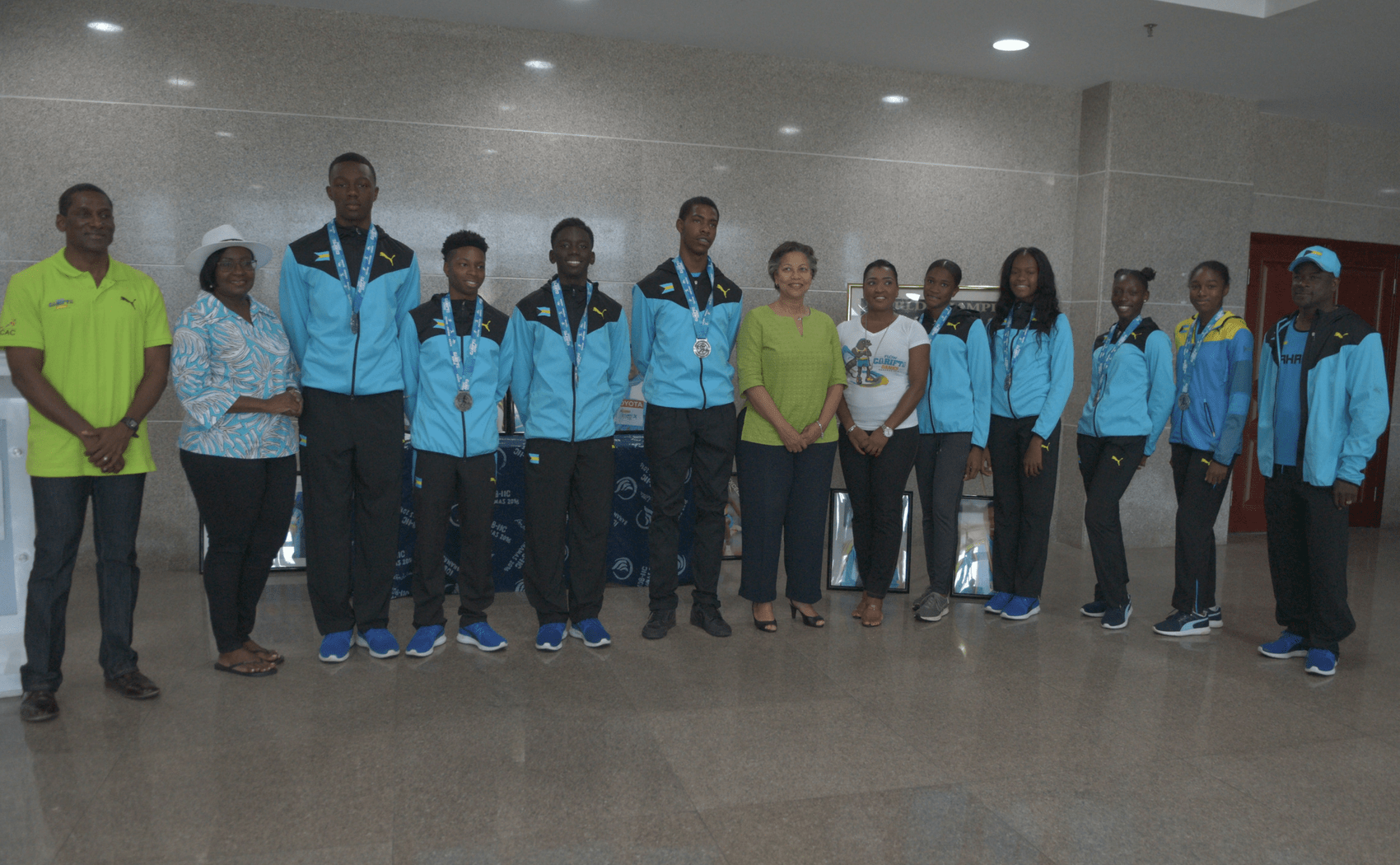 Local athletes receive long-awaited CARIFTA medals