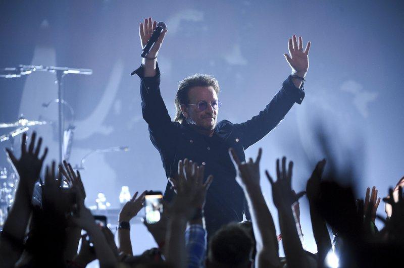 U2 dedicates song to Anthony Bourdain at Apollo show