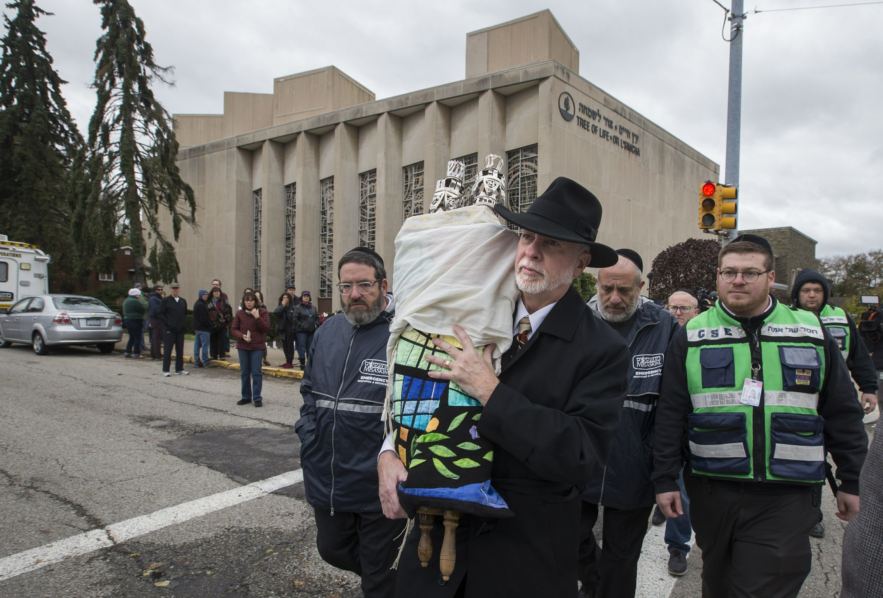 Rabbis gather up traces of Pittsburgh victims for burial