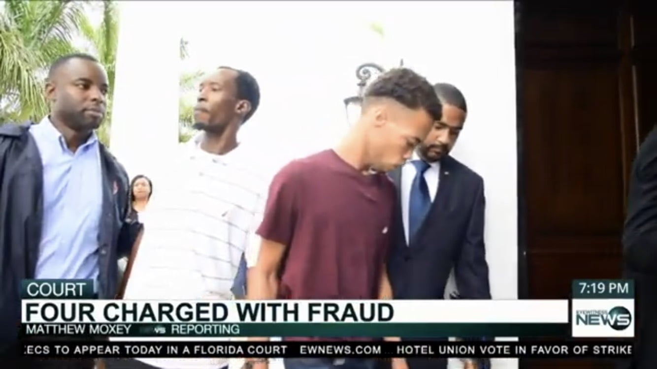 Four charged with fraud