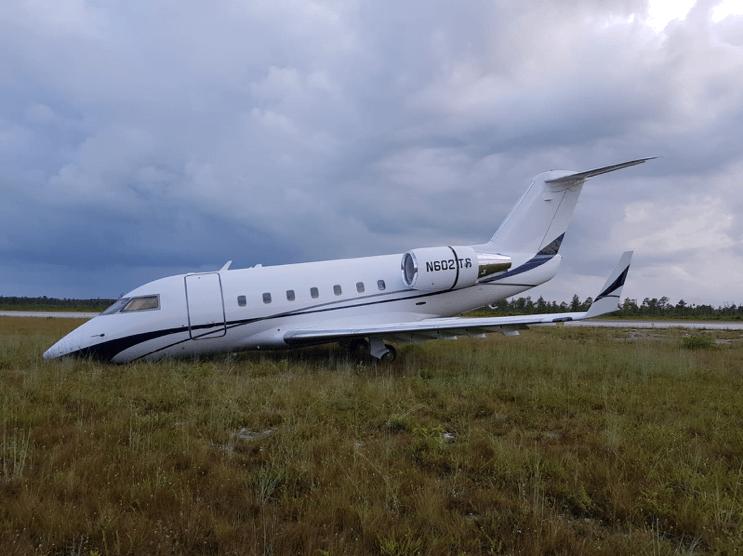Plane veers off runway in emergency landing