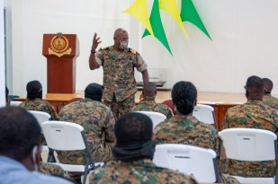 Senior Commander Frederick Brown (standing) addresses officers and marines ahead of the 2021 electoral period. (ABLE SEAMAN MICHAEL TURNER II)