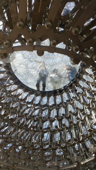 Looking at the glass floor of the 'Hive' installation, which is designed to bring attention to the importance of bees