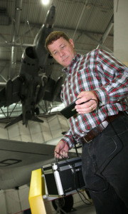 At the Imperial War Museum hangar in Duxford, UK, Scott Probasco, a Nokia senior manager, shows how a Nokia smartphone can connect to the Internet via TV white spaces and use an app to grab information about the planes on display. Image: Courtesy of Nokia