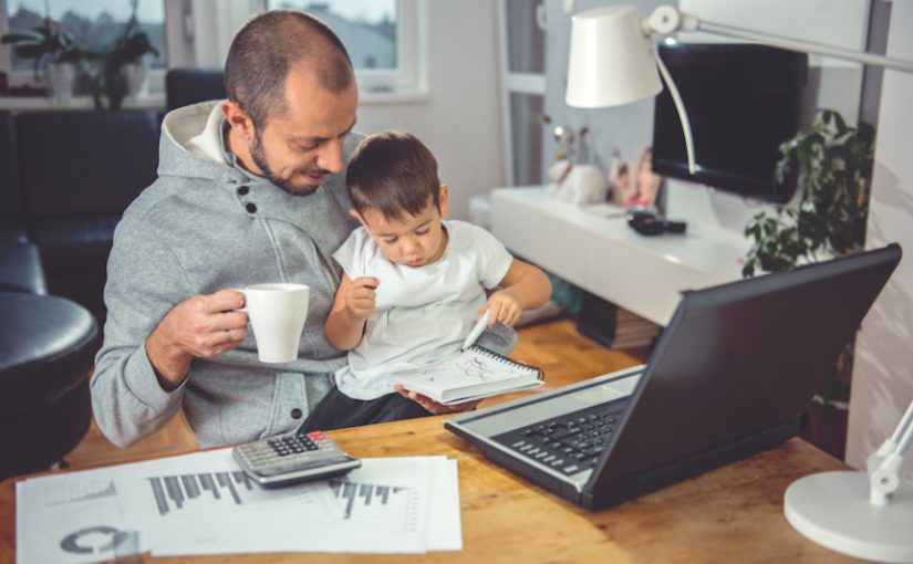 Father with son at working from home