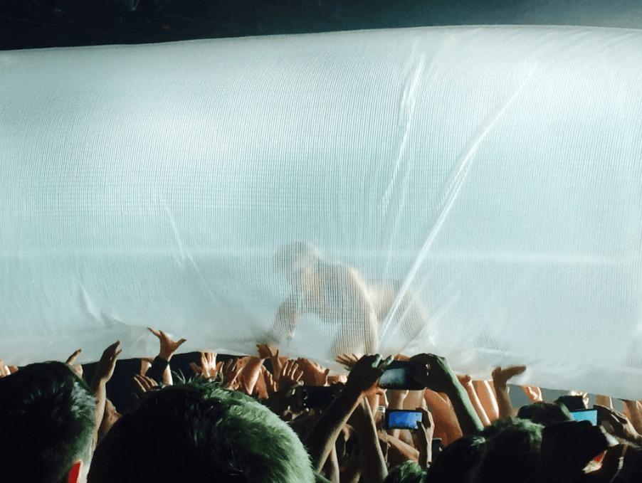 Peaches crowd surfs in latex