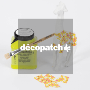 Décopatch logo in front of glue and decorated mache