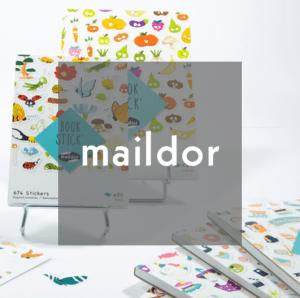 Maildor Logo in front of sticker books