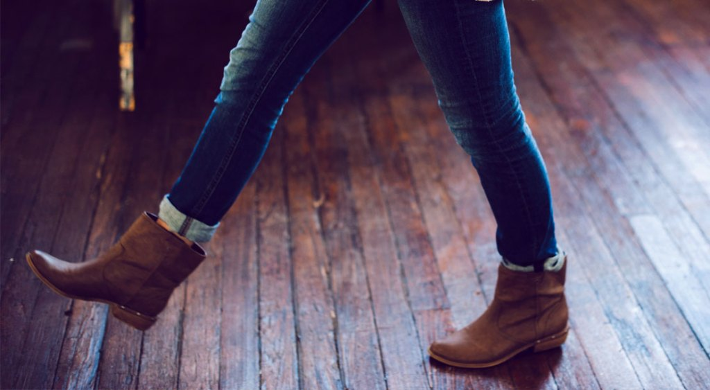 WomanWalkingAcrossWoodenFloor
