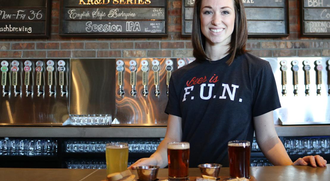 Image of woman serving behind bar