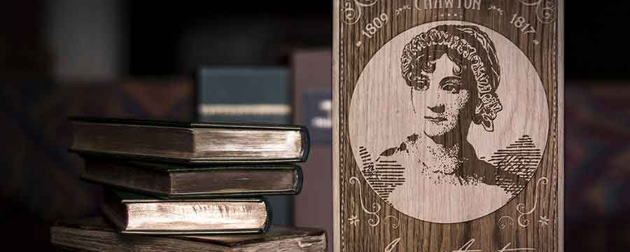 Image of a Jane Austen book in the front of a stack of books