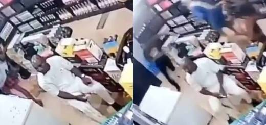 footage showing armed robbers robbing a wine shop