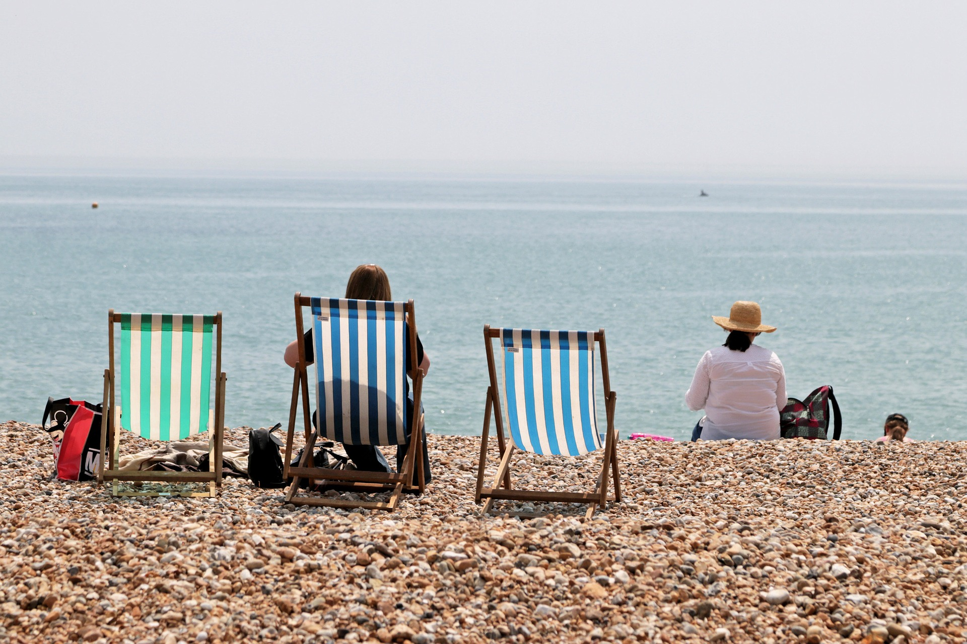 beach chairs in front of the sea