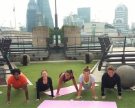 Staff from Janikin Rooke at Coq D'Argent rooftop Pilates