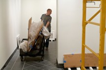 Matthew Callinan installs artists' work for The Wall in Our Heads.