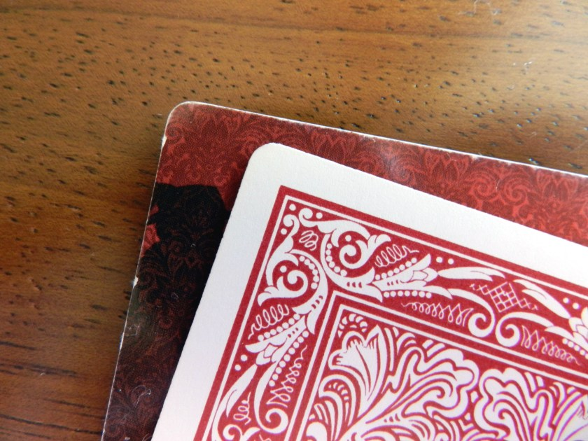 Love Letter card edge compared to typical playing card edge.