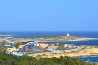 An abandoned waterpark, as seen from an open-top bus, somewhere near Selina Bay
