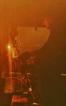 A welder in the round-house at the Chicago and Northwestern Railroad's Proviso Yard