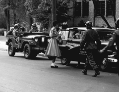 Soldiers from the 101st Airborne Division escort African-American students to Central High School in Little Rock in Sept. 1957