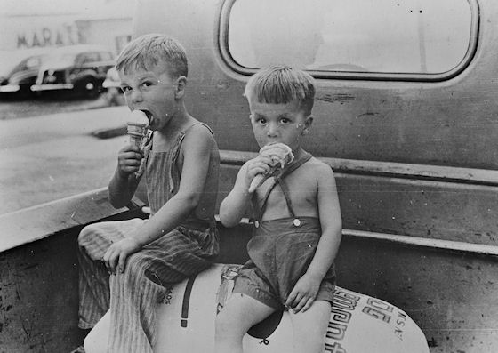 Farm boys eating ice-cream cones; Washington, Indiana
