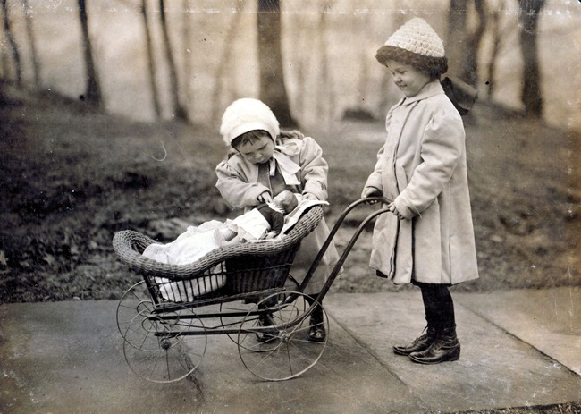 Children playing with Campbell Kid dolls. New York City, March 1912