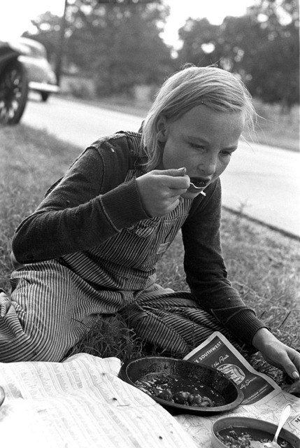 Daughter of white migrant eating lunch along the highway east of Fort Gibson, Muskogee County, Oklahoma