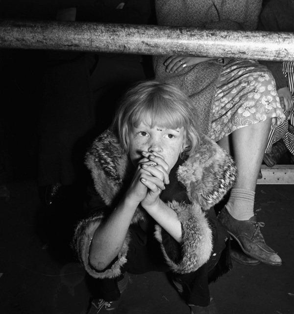 Undernourished cotton picker's child listening to speeches of organizer