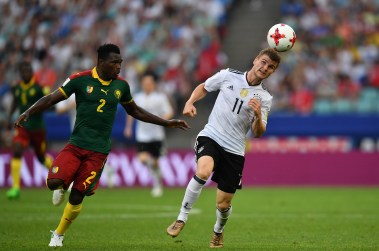 Germany's forward Timo Werner (R) challenges Cameroon's defender Ernest Mabouka during the 2017 FIFA Confederations Cup group B football match between Germany and Cameroon at the Fisht Stadium Stadium in Sochi on June 25, 2017. / AFP PHOTO / Yuri CORTEZ