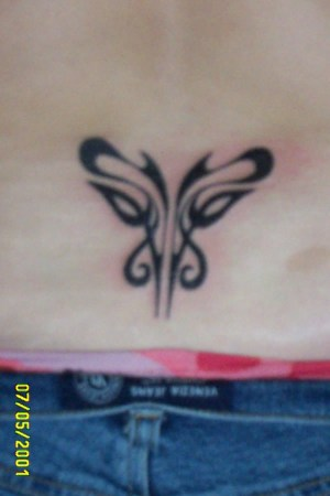 lower back tattoo was done 7/5/2001