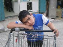 26. a boy with a cart