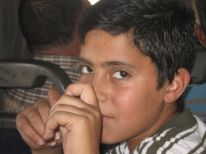 28. a Palestinian boy in the bus