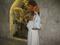 02. a Dominican griar with a statue of Mary