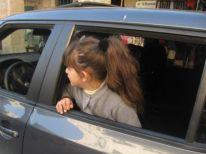 14. a girl in a car