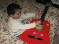 22. a young guitarist