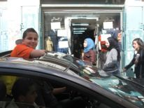05. a boy standing in a car