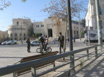 06. soldiers check a young man on bike