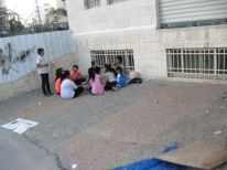 09. Palestinian children sitting together