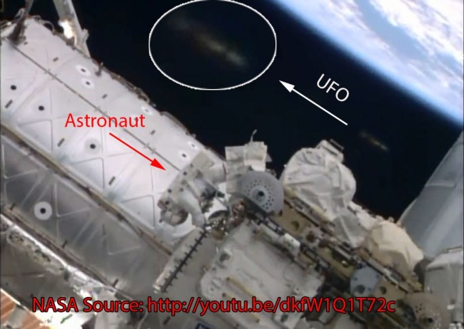 UFO near spacewalking astronauts