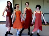 Dancers modeling their costumes
