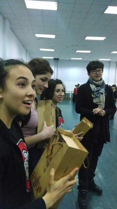 Alice Bacani, Kelly Hurlburt, and Tammy Carrasco receive tea as a gift from Changchun University students and staff. Photo by Leisa DeCarlo.