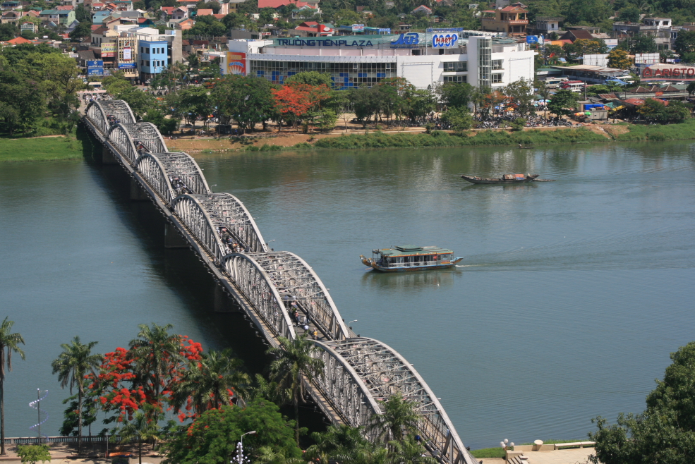 Truong Tien Bridge is reflected in the Huong River, Hue, Viet Nam - Expat Authority