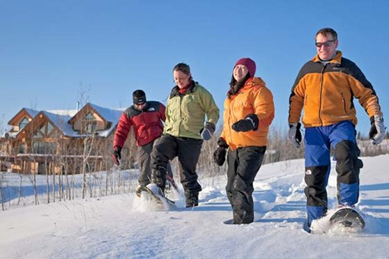 group_snowshoeing_at_a_lodge_near_whitehorse_yukon_