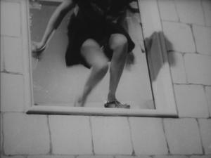 woman jumping from window